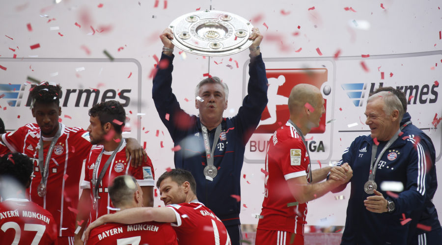 Football Soccer - Bayern Munich V SC Freiburg - Bundesliga - Allianz Arena, Munich, Germany - 20/5/17 Bayern Munich Coach Carlo Ancelotti Celebrates With The Trophy And Team Mates After Winning The Bundesliga  Reuters / Michaela Rehle Livepic DFL RULES TO LIMIT THE ONLINE USAGE DURING MATCH TIME TO 15 PICTURES PER GAME. IMAGE SEQUENCES TO SIMULATE VIDEO IS NOT ALLOWED AT ANY TIME. FOR FURTHER QUERIES PLEASE CONTACT DFL DIRECTLY AT + 49 69 650050.